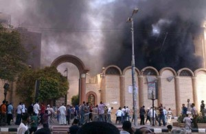 St. George's Coptic Church burns in Sohag City, Egypt, after arsonists set it ablaze.