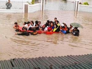 "Floodwaters have reached chest level in Barangay Bagbag 2 in Rosario, Cavite as of 11AM on Monday. It's even deeper elsewhere in Rosario, where Gov. Jonvic Remulla said a ""perfect storm"" has occurred: high tide combined with water rushing down from the uplands. Residents desperately need to be rescued, according to GMA News YouScooper Glacielle Abutin."