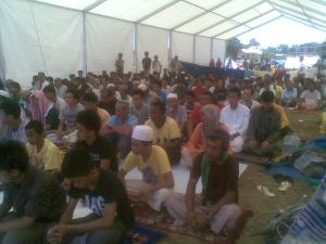 Muslim evacuees during their prayer time