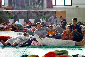 Refugees of the Islamic State's self-imposed sharia rest at a local shelter. Haidar Hamdani. AFP