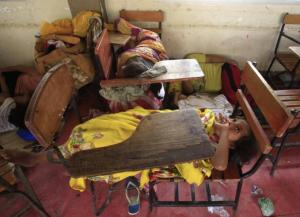 Children take a break inside an evacuation center after strong winds brought by Typhoon Rammasun battered the coastal bay of Baseco compound, metro Manila July 16, 2014.  REUTERS/Romeo Ranoco